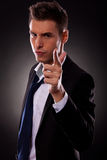 Young businessman making a gun gesture stock photos