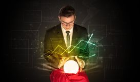 Businessman forecast the future of the stock market with a magic ball royalty free stock photo