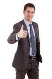Young businessman making thumbs up gesture Stock Photos