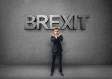 Young businessman making X sign by his arms on the concrete backround with 'brexit' word Royalty Free Stock Images