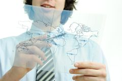 Young businessman with map of the world Stock Photography