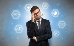 Sick businessman with medical care concept royalty free stock photo