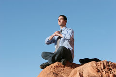 Young businessman meditating Royalty Free Stock Image