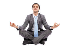 Young businessman meditating Stock Images