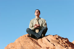 Young businessman meditating / relaxing Stock Photo