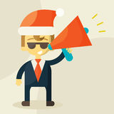 Young businessman with a megaphone and Christmas Royalty Free Stock Image