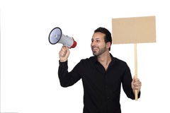 Young businessman with a Megaphone and a poster proclaiming some Stock Photography