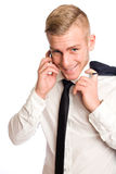 Young businessman with mischievious smile. Royalty Free Stock Image