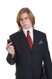 Young businessman with mobile. Handsome young businessman with long hair and mobile telephone, isolated on white background Stock Photos
