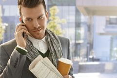 Young businessman on mobile outdoors. Young businessman on the way to work talking on mobilephone Stock Photos