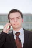 Young businessman with mobile phone Stock Images