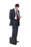 Young businessman with a mobile phone. Royalty Free Stock Image