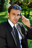 Young businessman with mobile phone Stock Photography