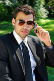 Young businessman with mobile phone Royalty Free Stock Photos