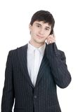 The young businessman with mobile phone Stock Photo