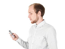 Young businessman with mobile phone isolated Stock Photo