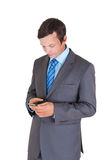 Young businessman with mobile phone Royalty Free Stock Images