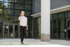 Young businessman with mobile phone. Young businessman with a mobile phone outside Stock Photo