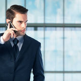 Young businessman with mobile phone Royalty Free Stock Photography