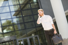 Young businessman with mobile phone Royalty Free Stock Photo