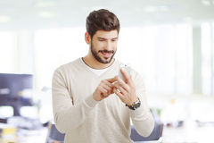 Young businessman with mobile Stock Image