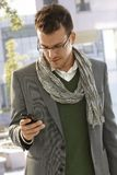 Young businessman with mobilephone. Young businessman using mobilephone outdoors Royalty Free Stock Photography