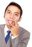 Young businessman with a mocking expression Royalty Free Stock Photos