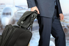 Young businessman  in  a modern  stylish suit with  luggage in Stock Photo