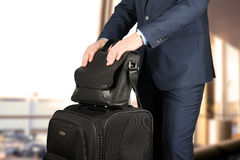 Young businessman  in  a modern  stylish suit with  luggage in Royalty Free Stock Photography