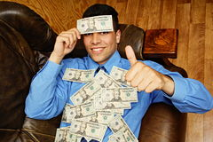 Young businessman with money on headed Royalty Free Stock Image