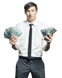 Young businessman with money Royalty Free Stock Photography