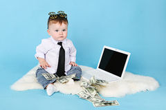 Young businessman with money and a lap Stock Photo