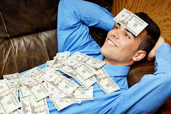 Young businessman with money and relaxes Stock Photos