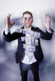 Young businessman with money tornado. Stock Photography