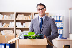 The young businessman moving offices after being made redundant. Young businessman moving offices after being made redundant Royalty Free Stock Image