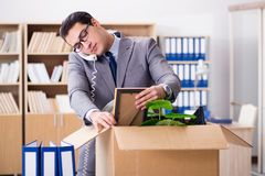 The young businessman moving offices after being made redundant Royalty Free Stock Photography