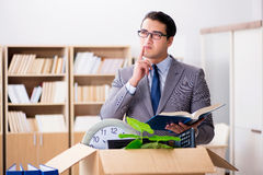 The young businessman moving offices after being made redundant Royalty Free Stock Images