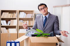 The young businessman moving offices after being made redundant Stock Photo