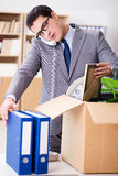 The young businessman moving offices after being made redundant Royalty Free Stock Photos