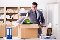 The young businessman moving offices after being made redundant Stock Photos