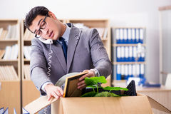 The young businessman moving offices after being made redundant Royalty Free Stock Image