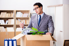 The young businessman moving offices after being made redundant Stock Photography