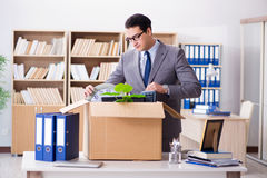 The young businessman moving offices after being made redundant. Young businessman moving offices after being made redundant Royalty Free Stock Photos
