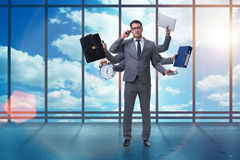 The young businessman in multitasking concept Royalty Free Stock Photos