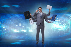 The young businessman in multitasking concept Royalty Free Stock Images