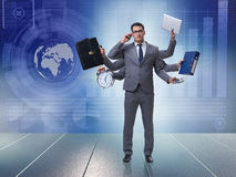The young businessman in multitasking concept Royalty Free Stock Photography