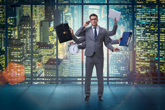The young businessman in multitasking concept Royalty Free Stock Photo