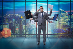 The young businessman in multitasking concept Royalty Free Stock Image