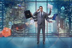 The young businessman in multitasking concept Stock Photo