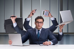The young businessman in multitasking concept Stock Photography